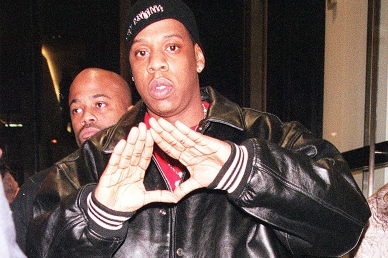 382034 02: (ITALY OUT) Hip Hop artist Jay-Z makes a symbolic hand gesture as he enters the Luxury Boutique on Madison Avenue in New York City where Cerrutti presented a new line of perfume, November 16, 2000. Many famous fashion figures were seen around town during this event. (Photo by Arnaldo Magnani/Liaison)